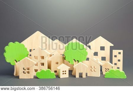 City Of Figures Houses And Green Trees. Real Estate Concept. Urbanism And Infrastructure. Realtor Se