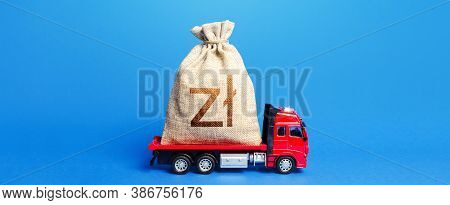 Truck Is Carrying A Big Polish Zloty Money Bag. Anti-crisis Measures Of Government. Great Investment
