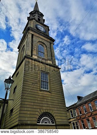 An Exterior View Of The Towering Clock Tower Steeple In The Town Of Falkirk In Scotland.
