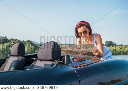 Happy Sincerely Smiling Woman Looking A Right Road In The Roadmap During Her Auto Travel In The Conv