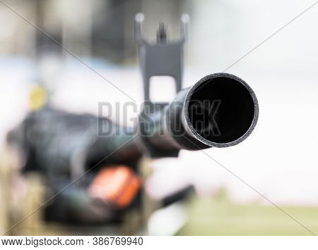 machine gun barrel with a close-up sight