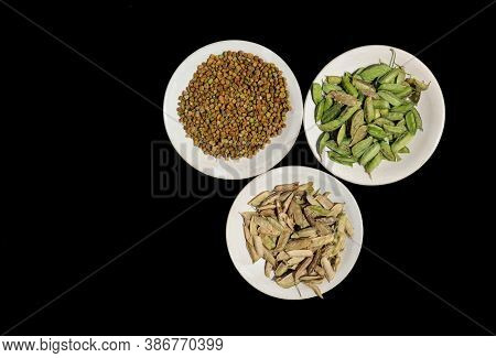 Grass Pea Seeds Or Cicerchia Pods In Plates Isolated On Black Background, Also Known As Lathyrus Sat