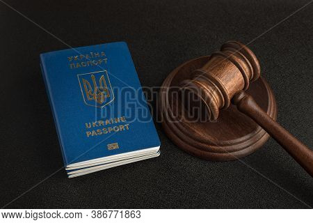 Passport Of A Citizen Of Ukraine And A Judicial Hammer On A Black Background. Legal Immigration. Obt
