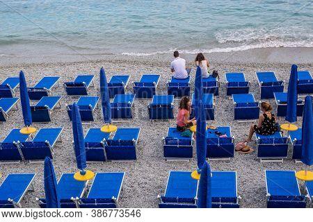 Monterosso Al Mare, Italy - July 8, 2017: View Of Tourists On Fegina Beach, Monterosso Al Mare, Cinq