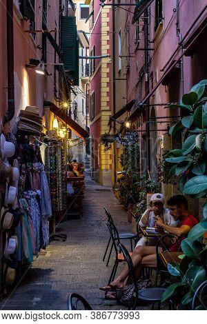 Monterosso Al Mare, Italy - July 8, 2017: View Of Tourists And Narrow Alley In Monterosso Al Mare Ol