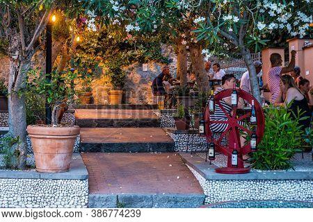 Monterosso Al Mare, Italy - July 8, 2017: People Sitting At A Restaurant In Monterosso Al Mare, Cinq