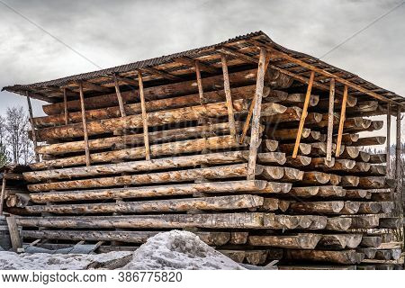 Air Drying Wooden Planks In Large Timber Stack. Seasoning Lumber Or Wood For Construction Industry I