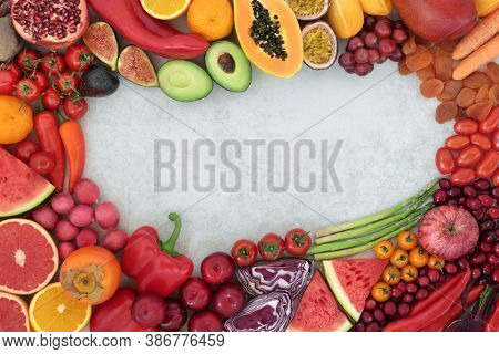 Plant based vegan health food border high in lycopene with fruit & vegetables also high in antioxidants, anthocyanins, vitamins, carotenoids, minerals, vitamins & fibre. Immune system boosting.