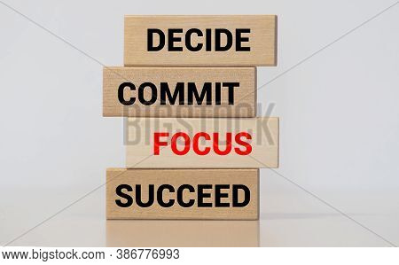 Motivational And Inspirational Quote Decide, Commit, Focus, Succeed Written On Wooden Blocks. With V