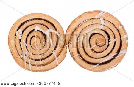 Freshly baked cinnamon bun rolls isolated on white background
