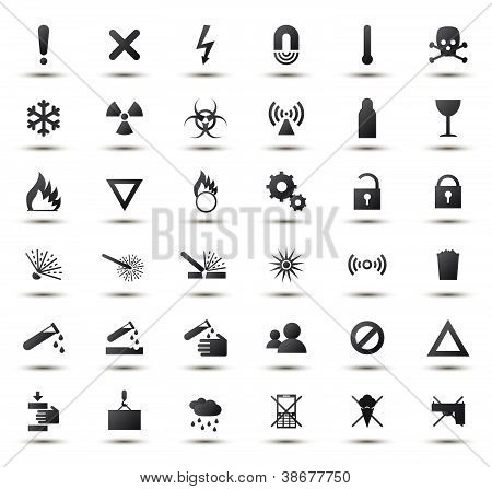 Black warning and danger signs