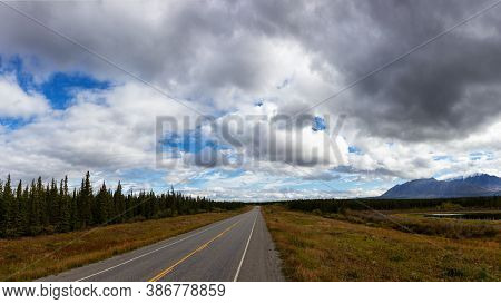 Scenic Route, Alaska Hwy, During A Sunny And Cloudy Day. West Of Whitehorse, Yukon, Canada. Panorami