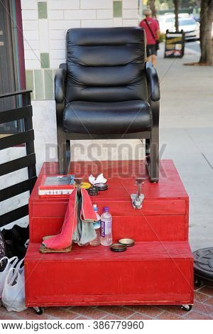 Santa Ana, California / USA - September 23-2020: Shoe Shine Stand. A Shoe Shine Station with a Chair and Cleaning and Shining products outside. Shiny shoes are a sign of fashion. Editorial Use Only.