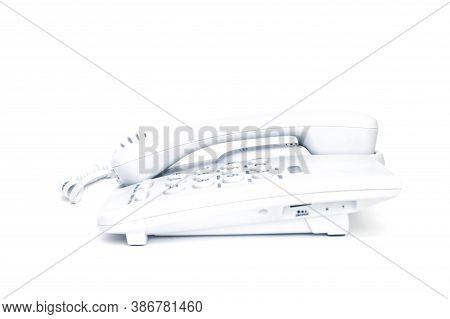 White Push-button Old Landline Telephone On Isolated White Background Close Up. High Quality Photo