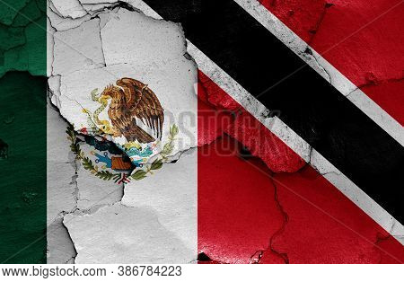 Flags Of Mexico And Trinidad And Tobago Painted On Cracked Wall