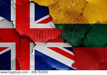 Flags Of Uk And Lithuania Painted On Cracked Wall