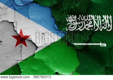Flags Of Djibouti And Saudi Arabia Painted On Cracked Wall