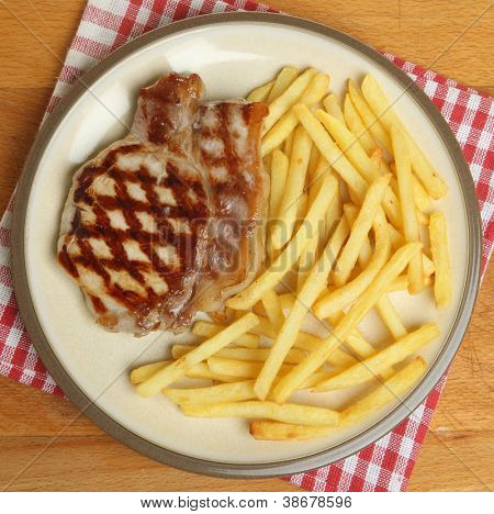 Chargrilled pork steak with fries