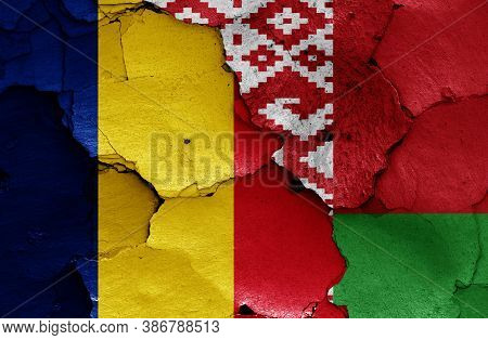 Flags Of Romania And Belarus Painted On Cracked Wall