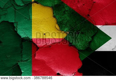 Flags Of Benin And Sudan Painted On Cracked Wall