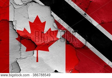 Flags Of Canada And Trinidad And Tobago Painted On Cracked Wall
