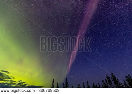 Northern Lights, Aurora Borealis, In The Canadian Nature At Night. Taken Near Whitehorse, Yukon, Can