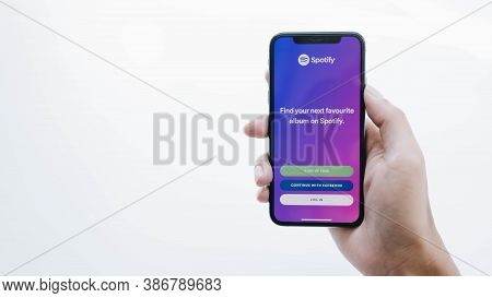 Chiang Mai, Thailand - Jul 17 2020: Person Holding A Brand New Apple Iphone Xs With Spotify Logo On