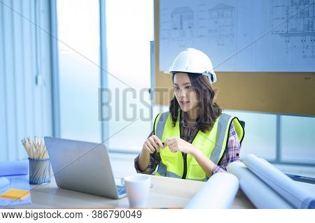 Female Engineer Using Laptop, Making Video Call To Client Or Business Partner