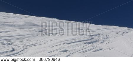 Natural Patterns In Windswept Snow On A Mountaintop In Winter