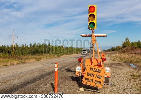 Yukon, Canada - August 27, 2020: Red Light Stop Sign At The Construction Site Working On Road, Klond