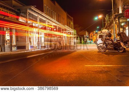 Santa Fe Usa - September 15 2015; Motorcycle Parked On Street Outside Buildings, Light Trails And Si