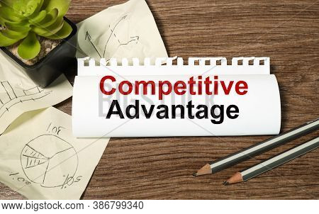 Comprtitive Advantage. Text On White Paper On Wood Background