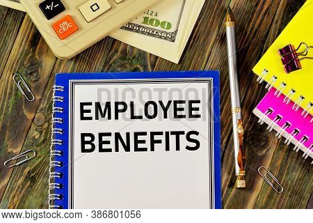 Employee Benefits - Text Inscription In The Planning Form On The Background Of Office Supplies. Bene
