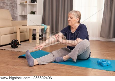 Senior Healthy Woman Practicing Fitness At Home. Old Person Pensioner Online Internet Exercise Train