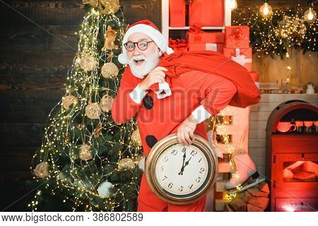 Santa Claus. Portrait Of Surprised And Funny Santa. Santa Claus With Alarm Clock. Greeting Christmas