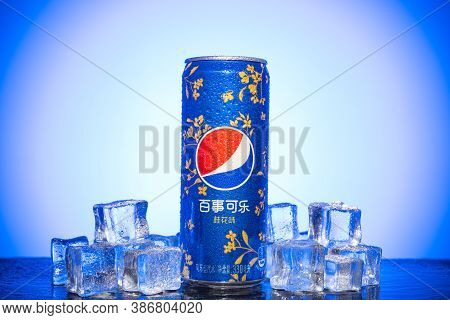 Zhongshan China-september 25,2020:logo Side Of Can Of Pepsi Sweet-scented Osmanthus With Ice Blocks.