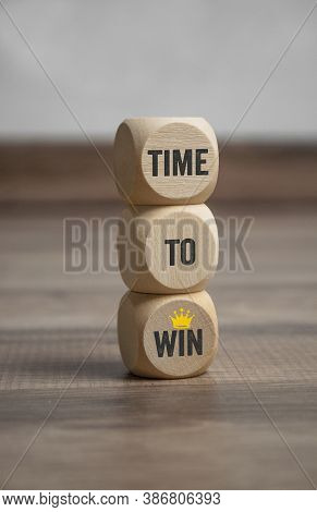 Cubes And Dice With Time To Win And Crown On Wooden Background