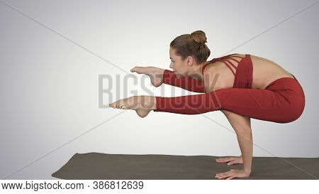 Beautiful Young Fit Woman Wearing Sportswear Doing Handstand, Va