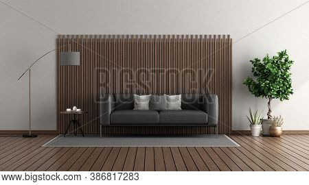 Modern Living Room With Black Leather Sofa In Front Of A Wooden Panel - 3d Rendering