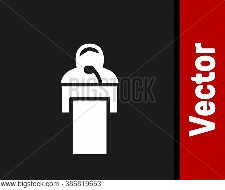 White Gives Lecture Icon Isolated On Black Background. Stand Near Podium. Speak Into Microphone. The