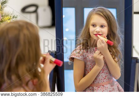 Charming Long Haired Girl Applying Lipstick In Front Of Mirror, Rare View Of Lovely Preteen Girl Pre