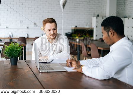 Successful African American Black Businessman Talking To Caucasian European Business Partner About N