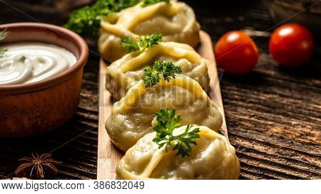 Traditional Turkish Manti With Yoghurt. Manti. Traditional Meat Dish Of The Peoples Of Central Asia.