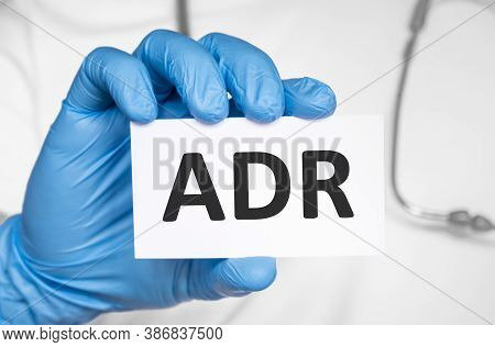 Doctor Holding A Card With Text Adr Adverse Drug Reaction, Medical Concept