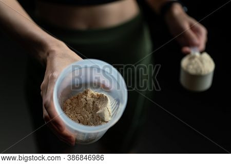 Close Up Of Women With Measuring Scoop Of Whey Protein, Jar And Shaker Bottle, Preparing Protein Sha