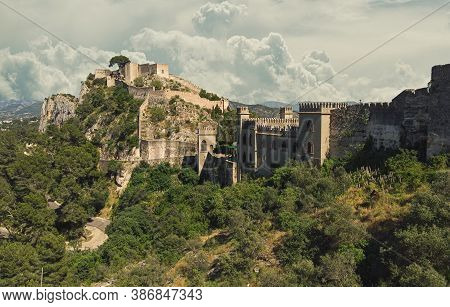 Aerial Image Picturesque View To Ancient Famous Castle Of Xativa Against Cloudy Sky Background. Span
