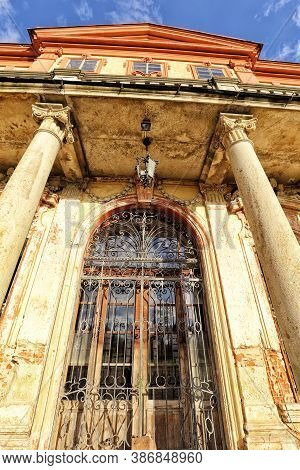 Detail Of The Entry Door Of The Abandoned Castle With Ornamental Bars And Columns