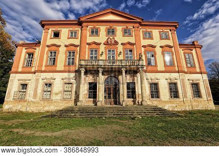 Large Unused Monumental Building Of The Libechov Castle With Balcony And Red Facade