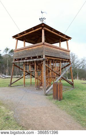 Low Square Wooden Outlook Tower With Stairways And Cameras On Top