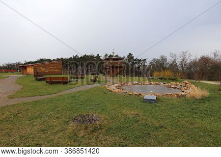Park With Small Pond, Outlook Tower And Wooden Shed In Autumn
